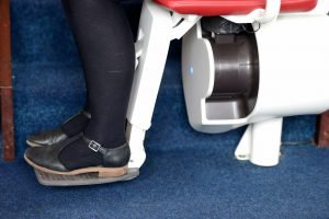 Close up picture of a stairlift in use
