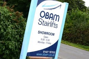 Photograph of the sign outside Obam Stairlifts showroom