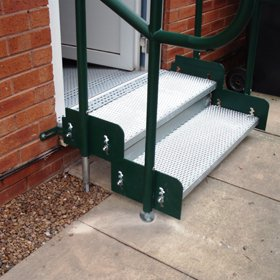 Picture of Access steps with a secure handrail. Can be added to platforms on modular ramps