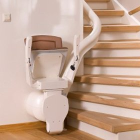 Picture of curved stairlift at the bottom of a staircase