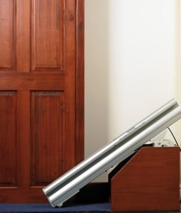 """""""Picture of hinged rail in lowered position across a door"""
