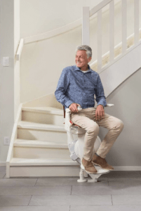 Picture of man about to use the otolift Air curved stairlift