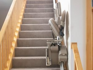 Picture of Bruno Elite folded on the stairs demonstrating plenty of room for other stair users
