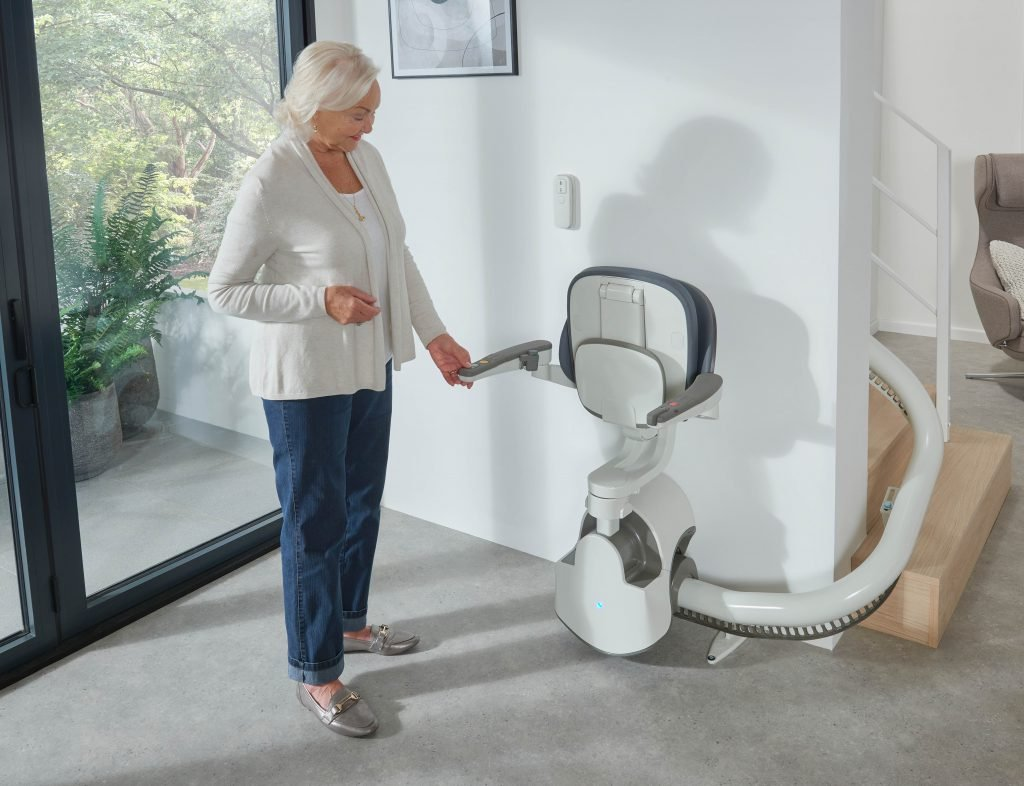 Client admiring her new FlowX stairlift
